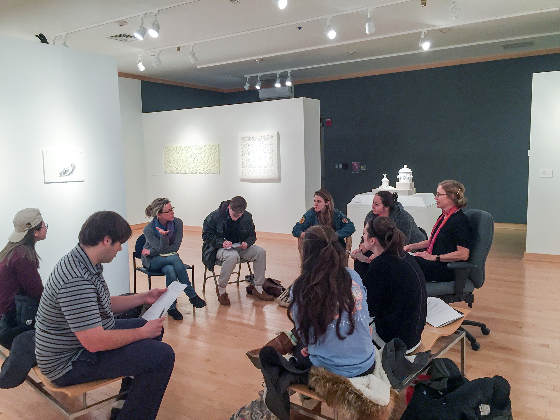 Senior Seminar students meeting in Kohl Gallery to discuss capstone exhibition