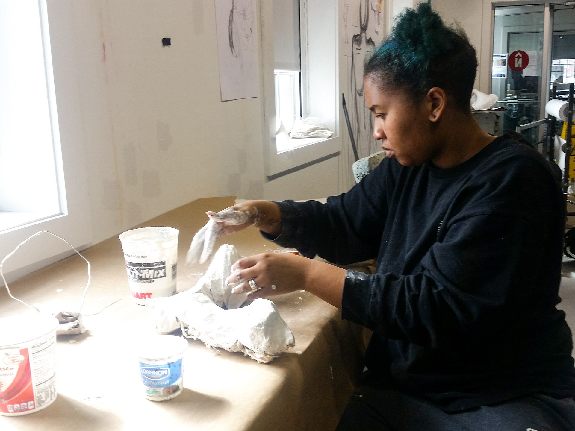 Student works with plaster in studio classroom