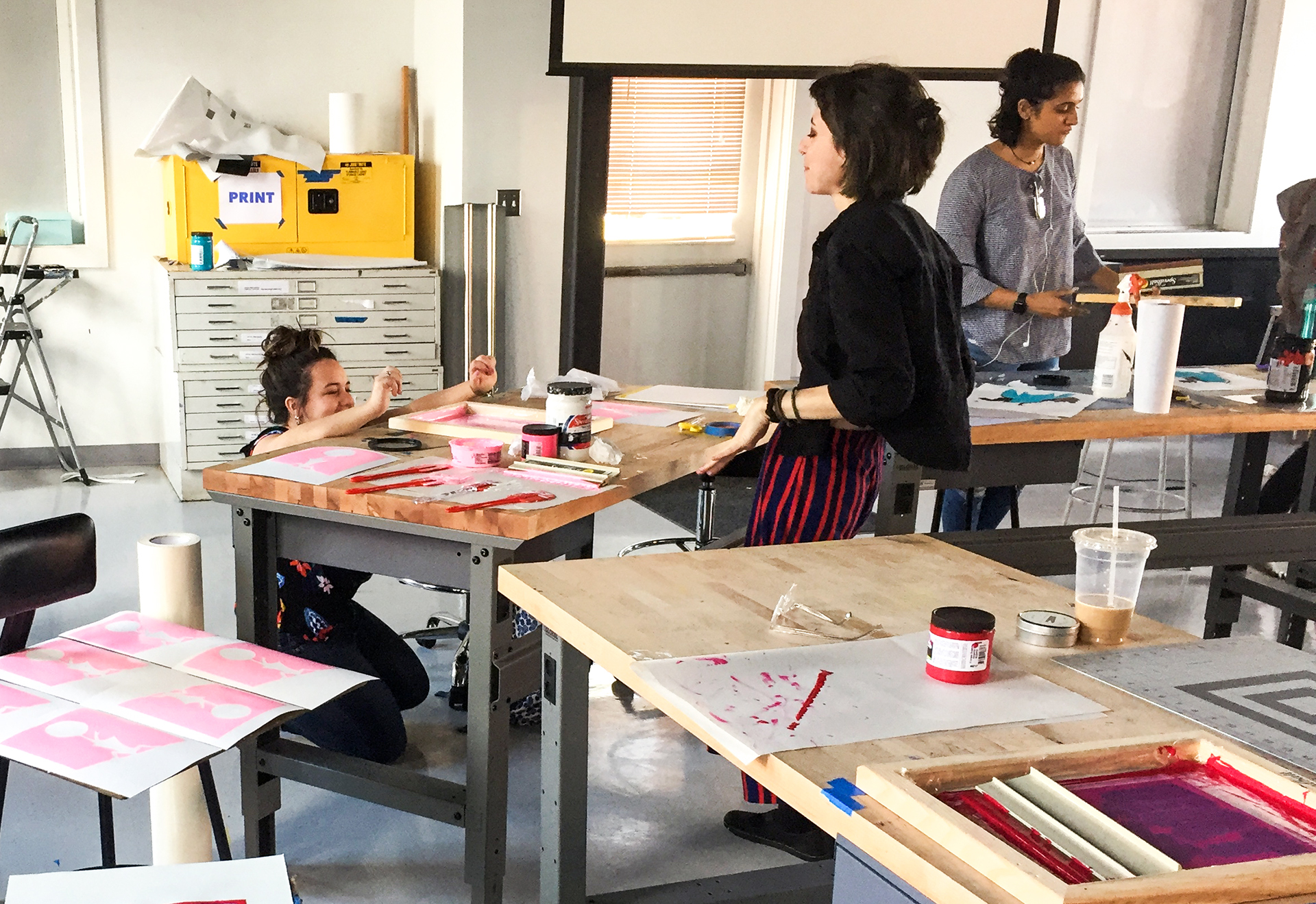 Students working collaboratively in a printmaking class