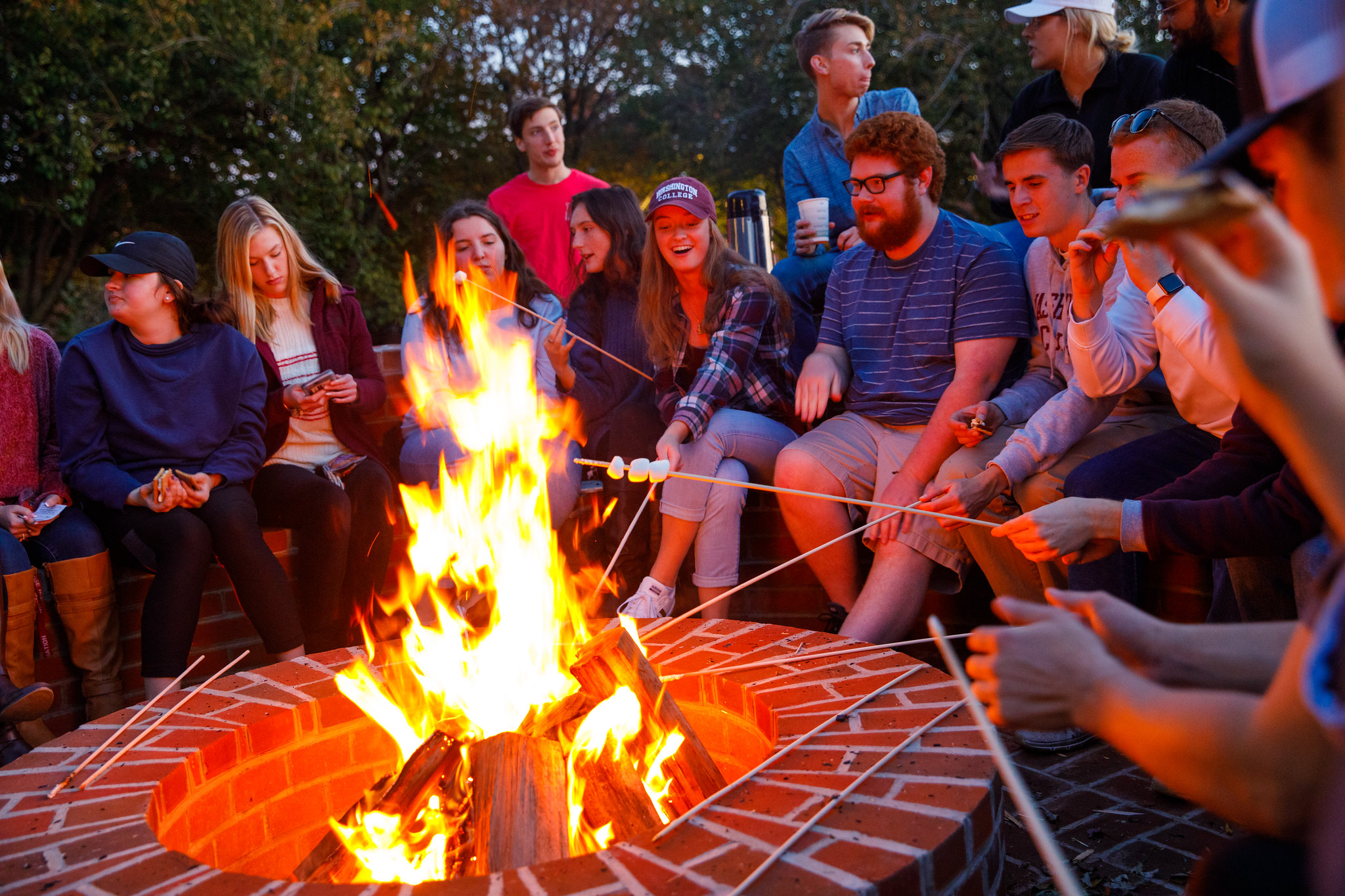 students roasting marshmellows