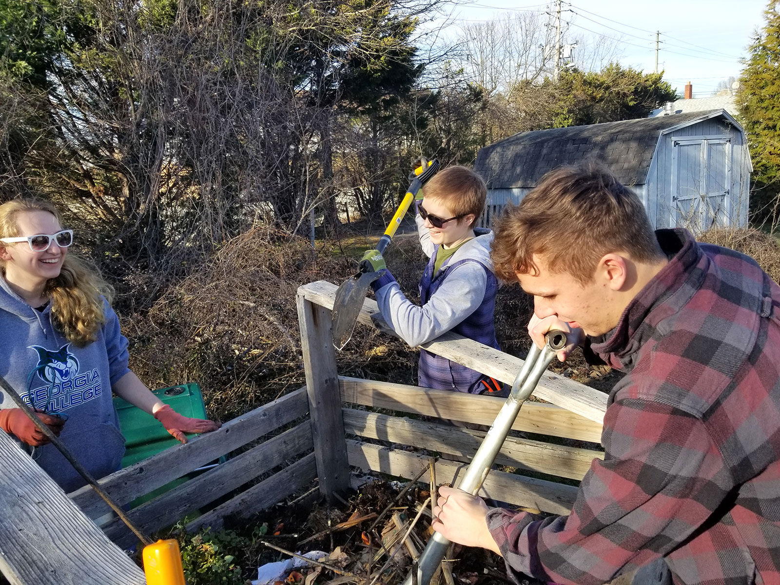 Students create a new 18-day compost pile at the campus garden.